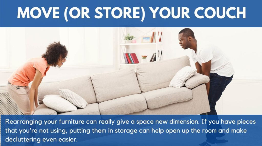 A couple moving a sofa around their house or apartment. This shows how rearranging furniture can really change the look of a space or room.